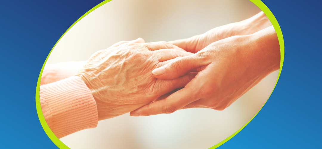 care taker holding elderly persons hands